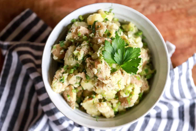 bowl of potato salad with no mayo and herbs