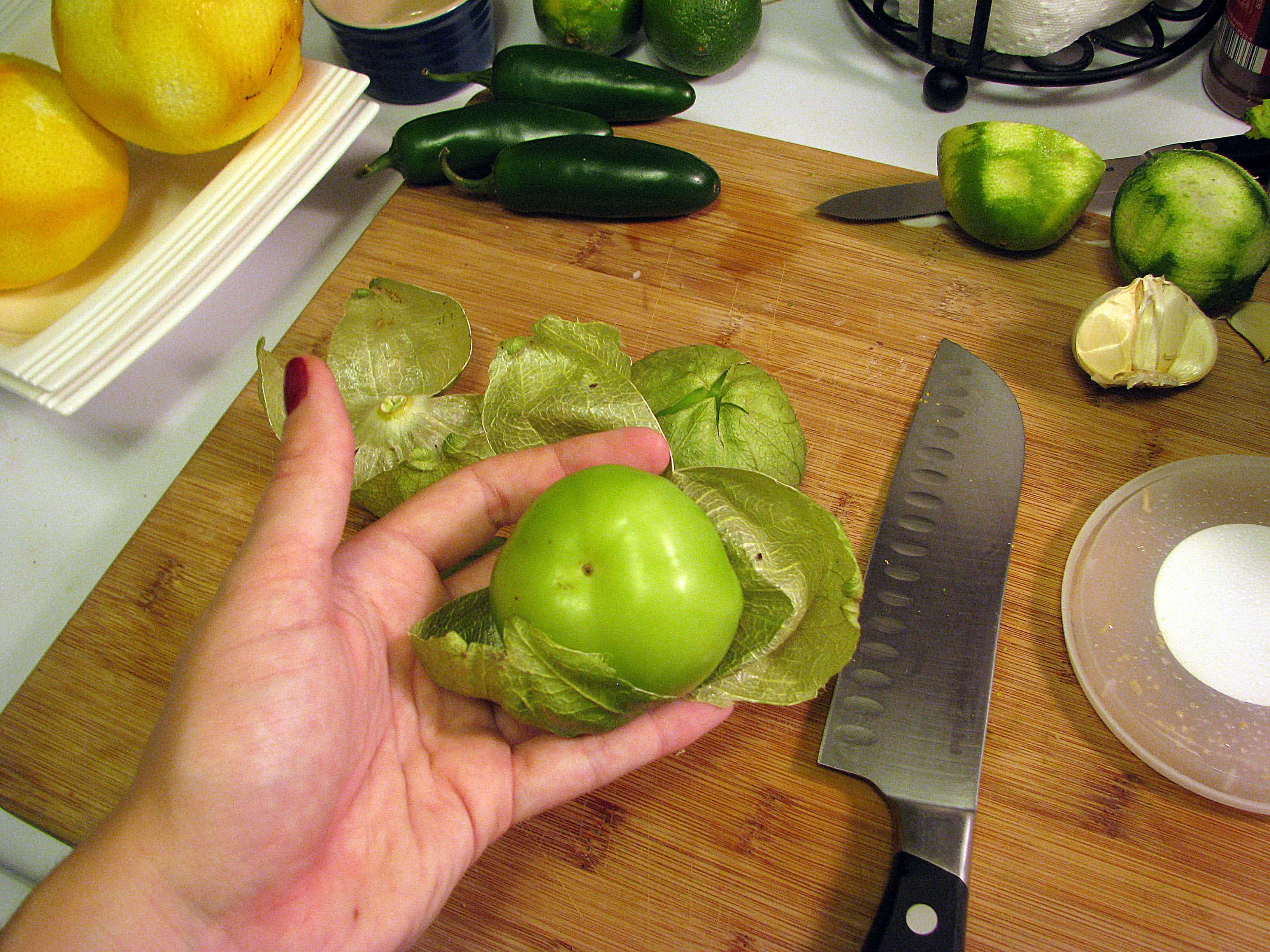 Remove skin from tomatillos