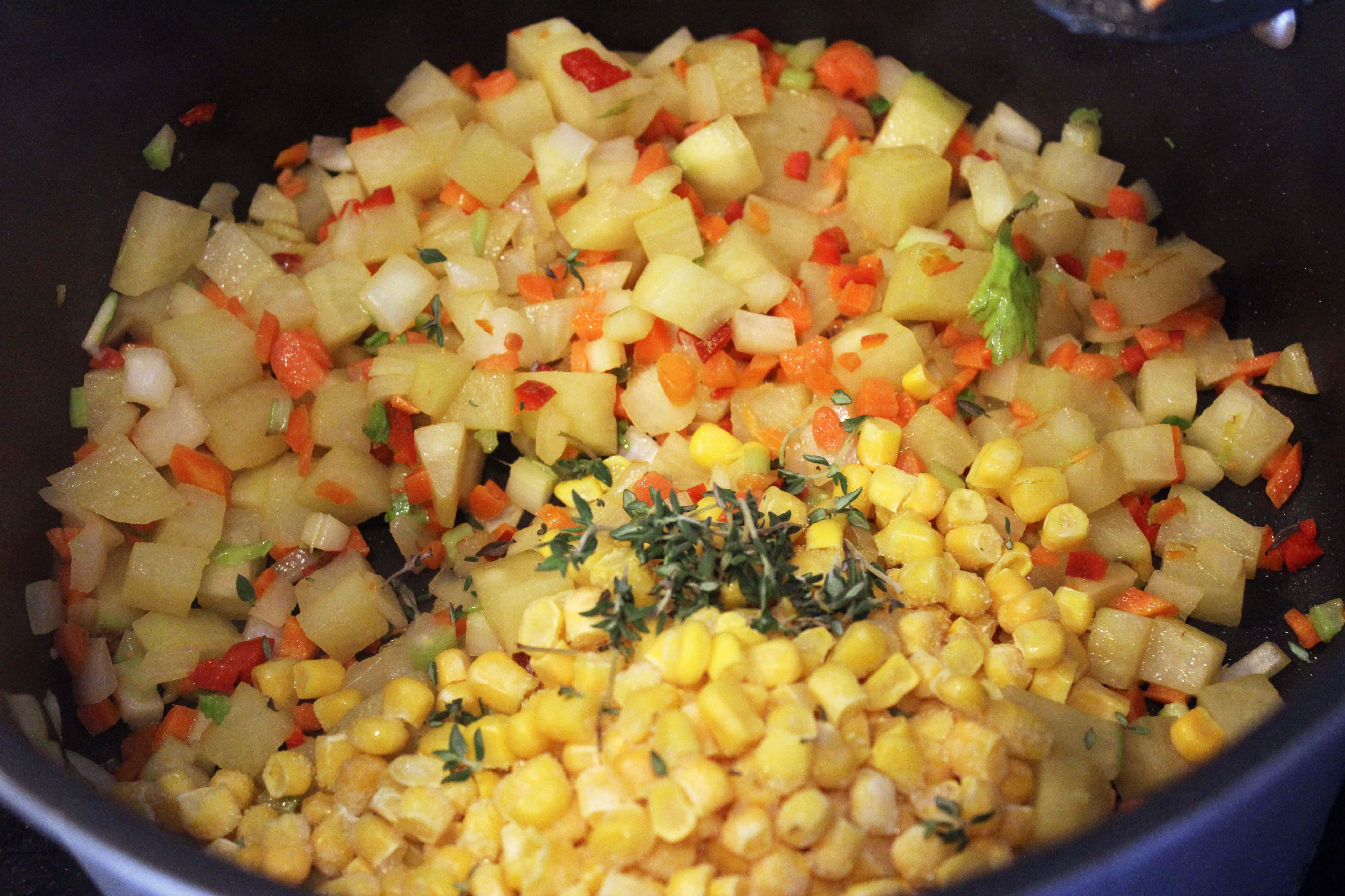 Add corn and thyme to veggies