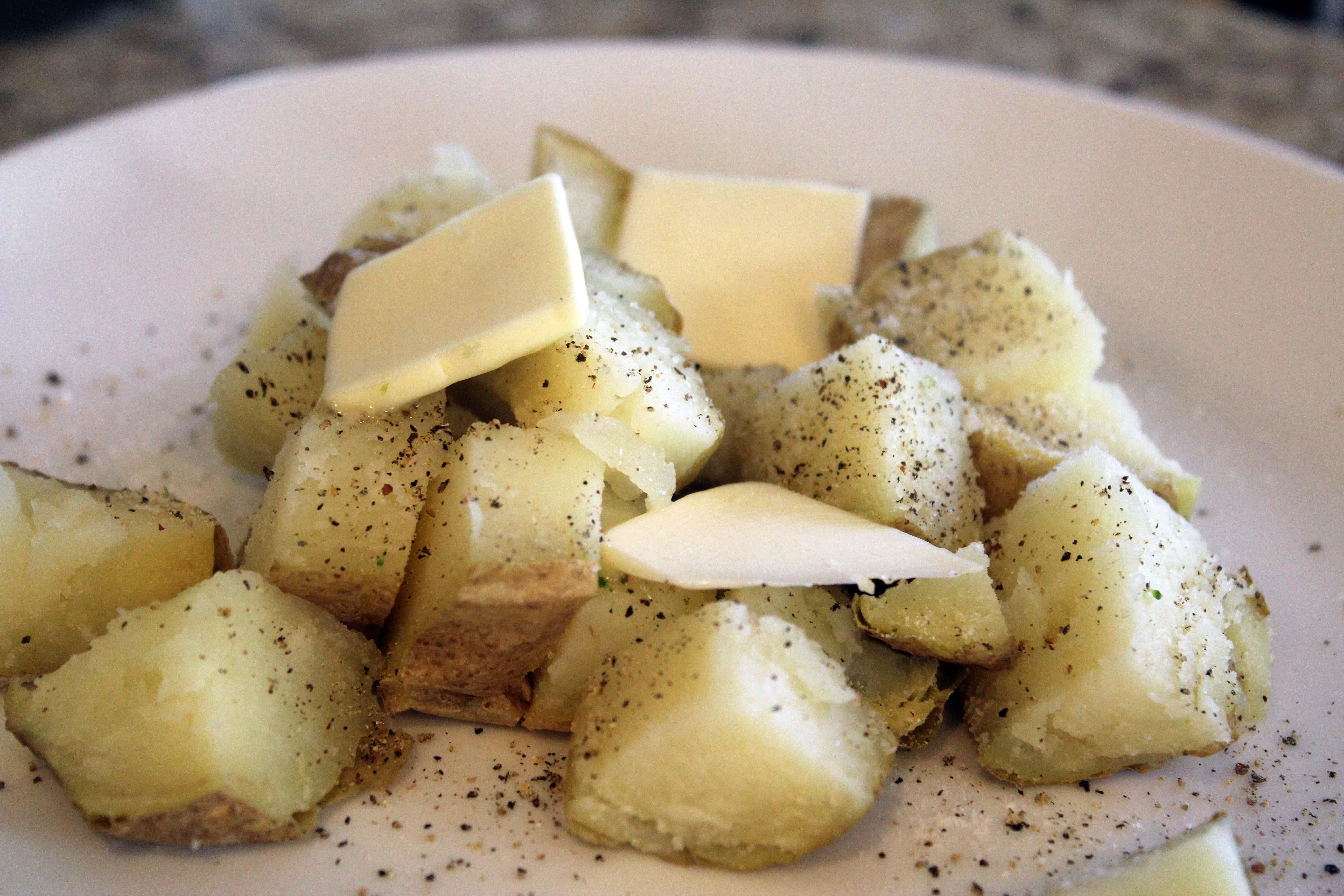 Cubed potato with salt pepper butter