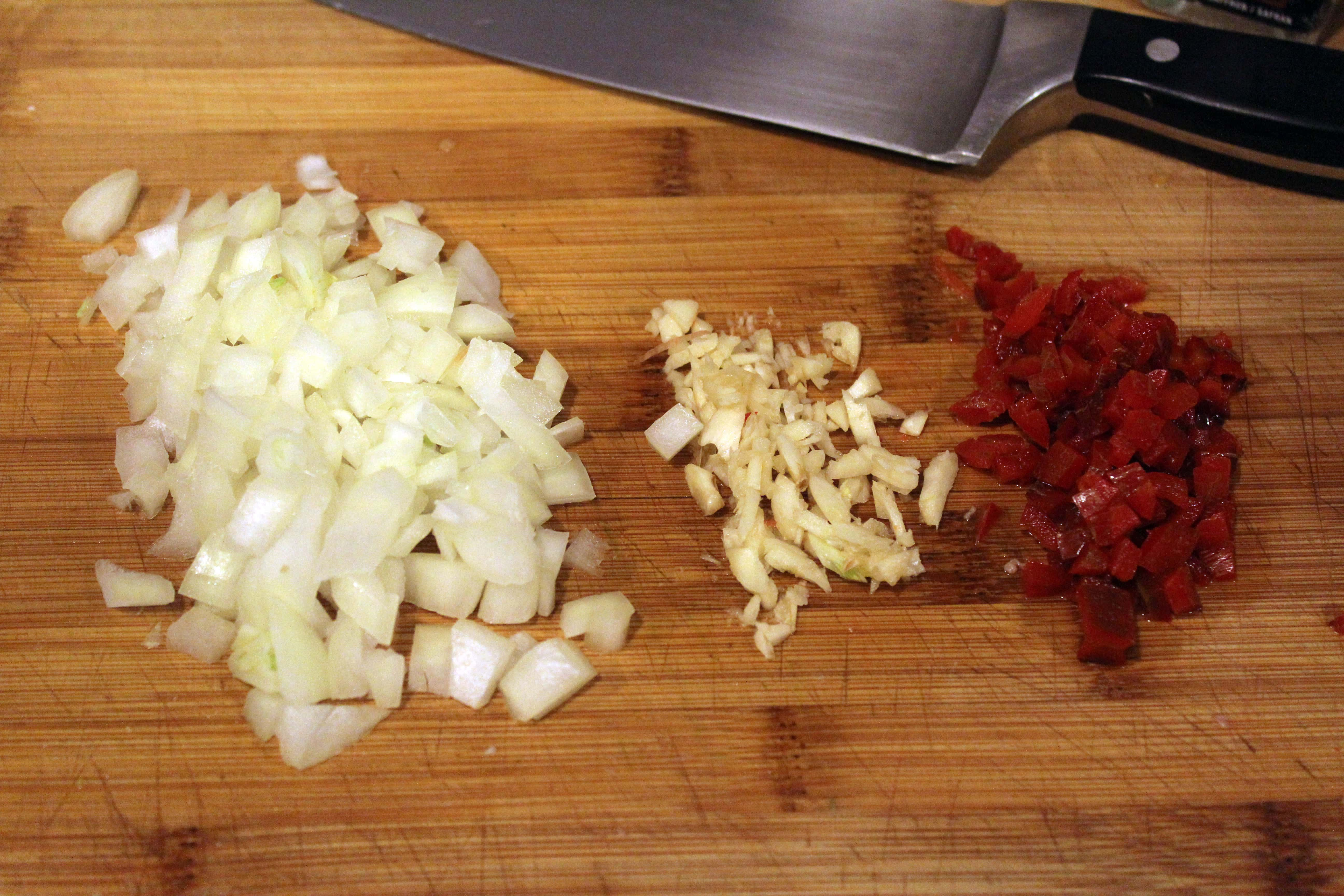 Finely chop onion garlic and peppers