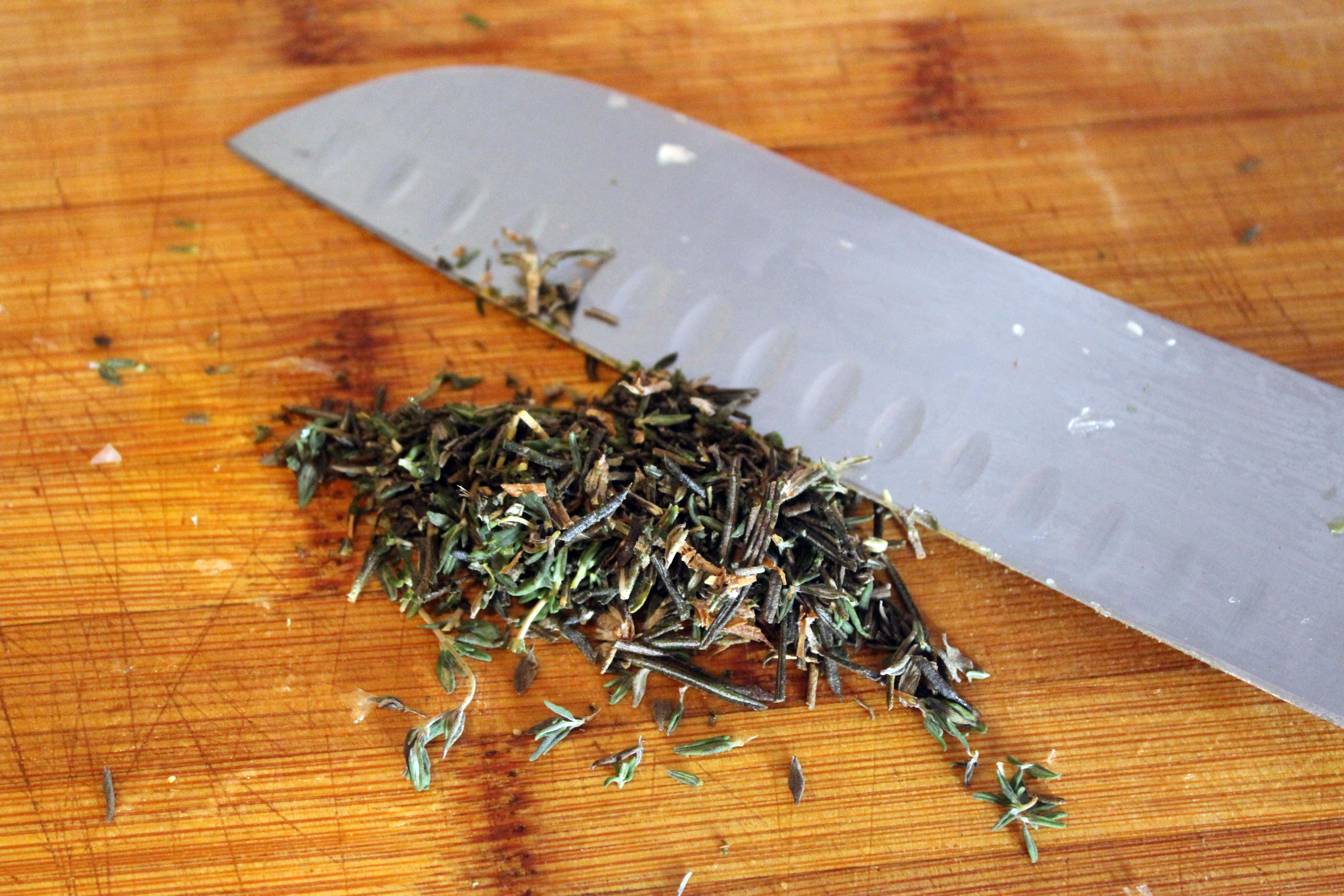 Finely chop thyme and rosemary