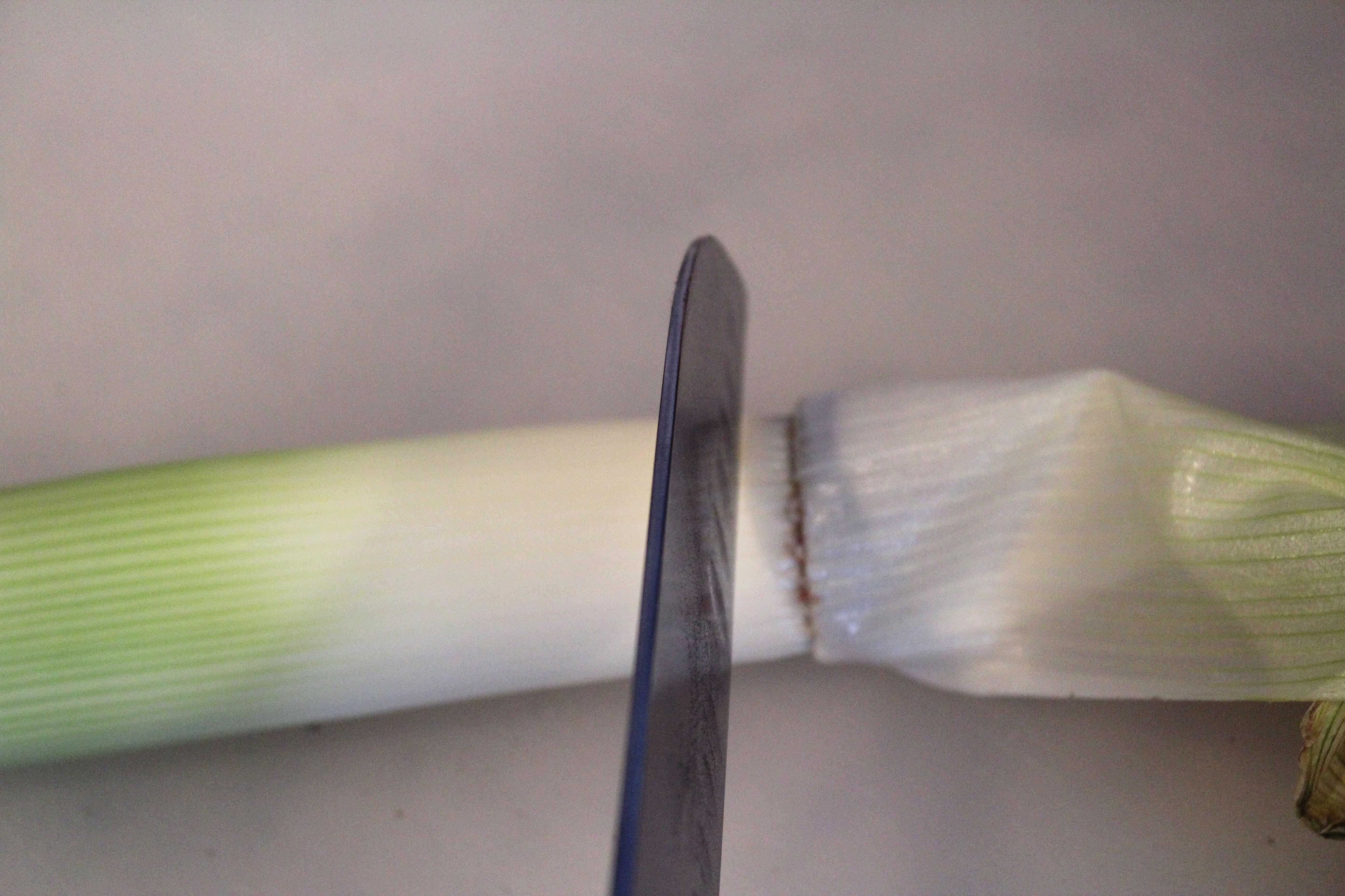 Slice end off leek
