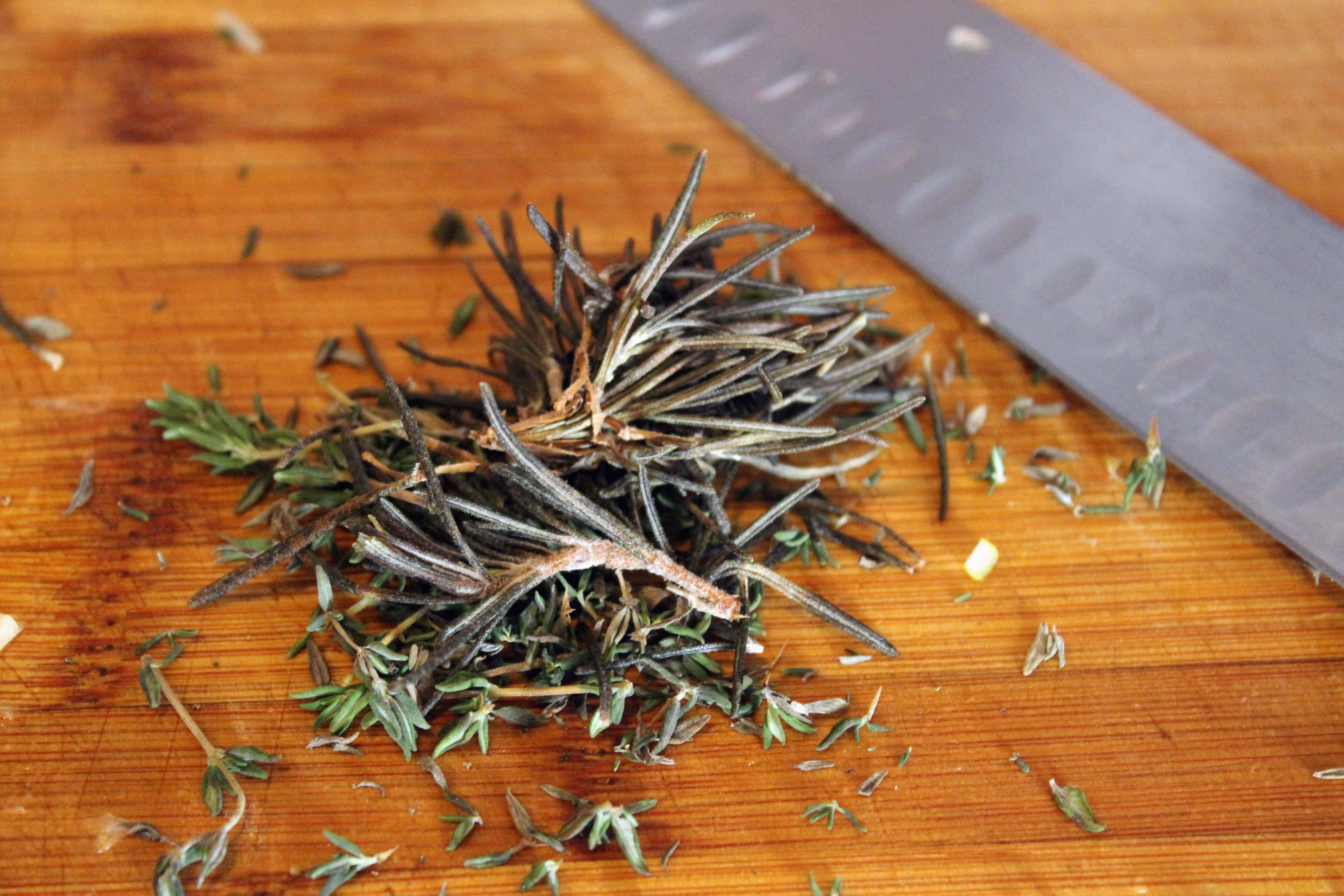 Strip thyme and rosemary from stems