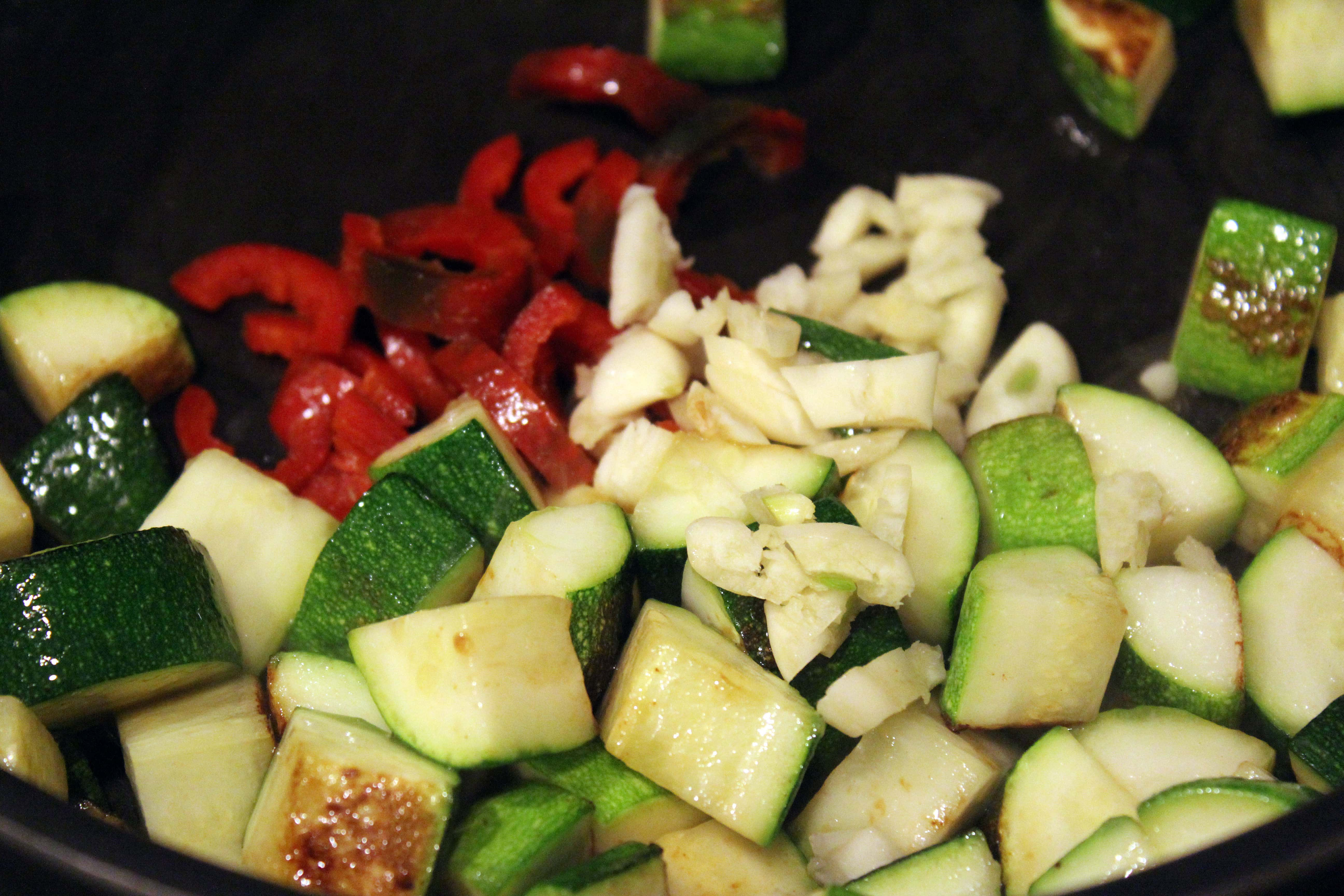 Add garlic and chili to cooked zucchin