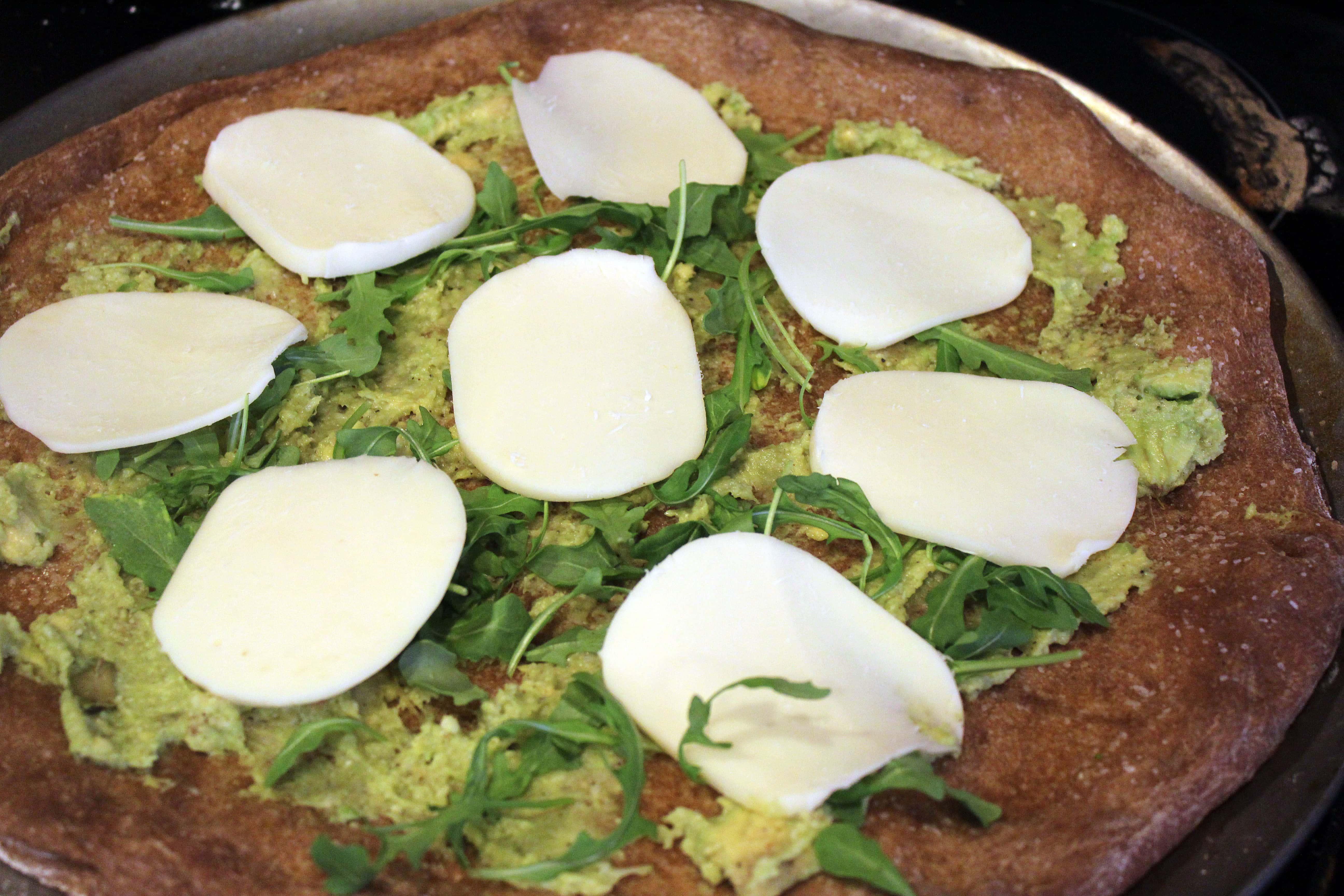 Add mozzarella to arugula and spread