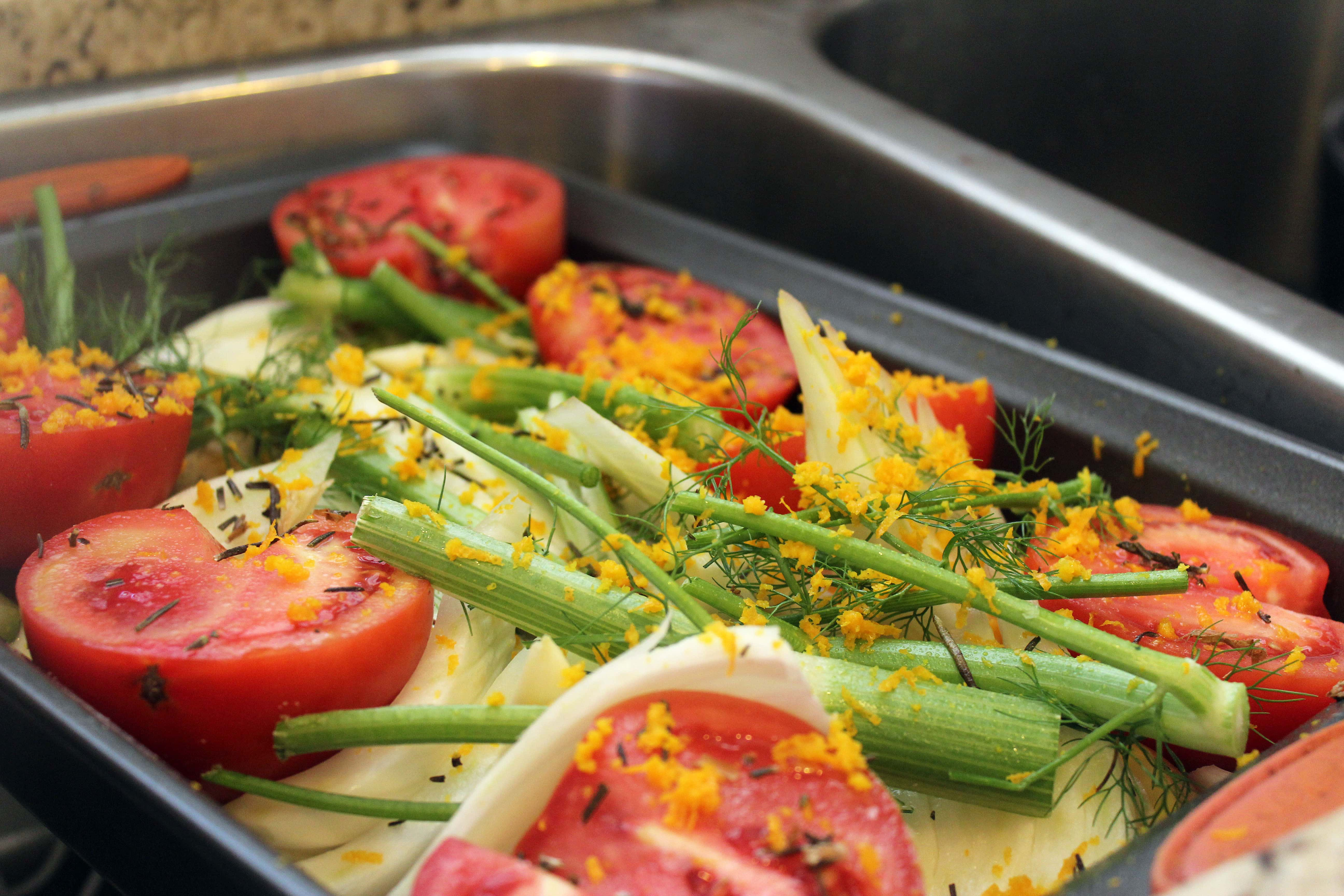Add rosemary and salt and zest over veggies