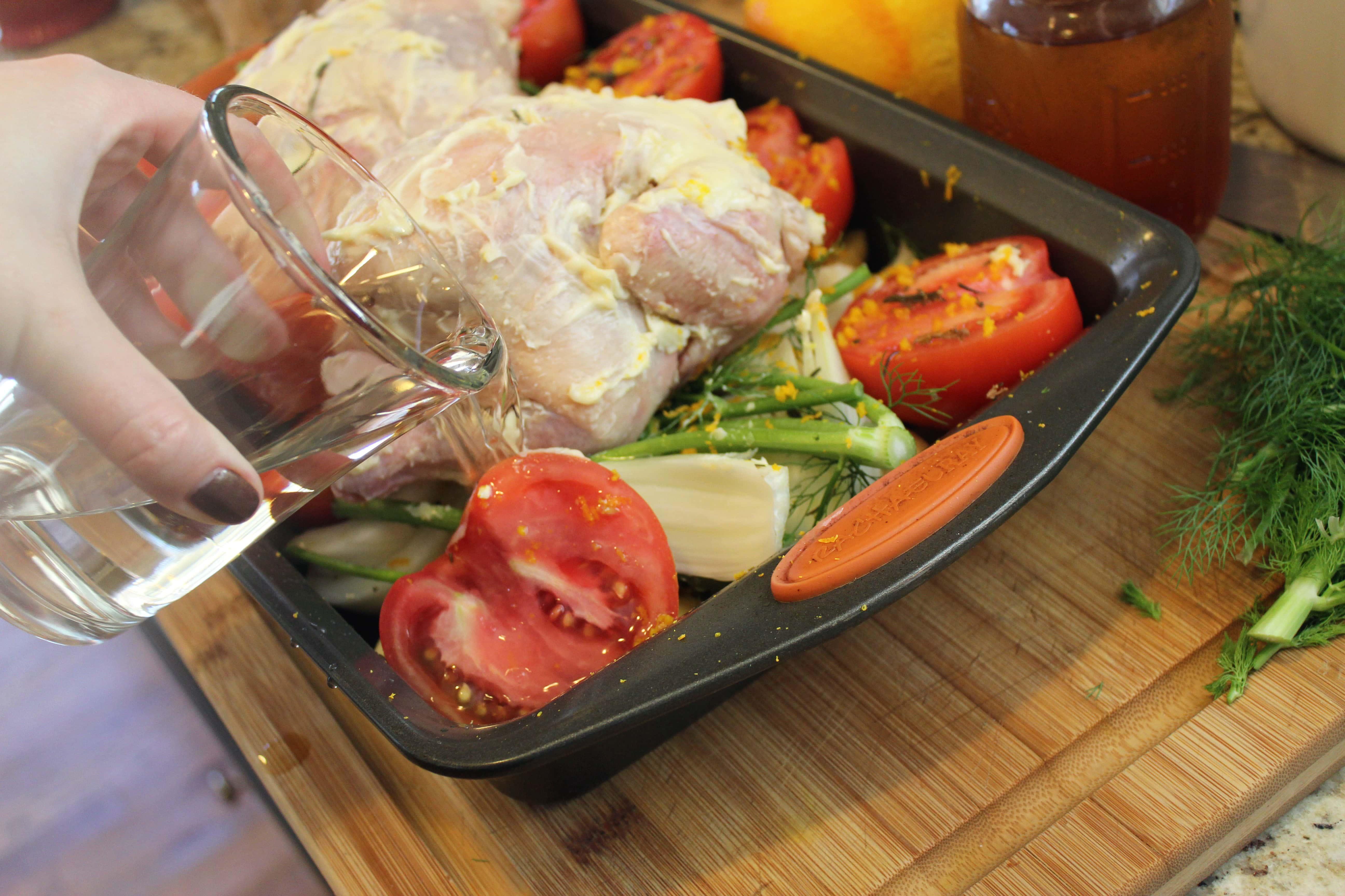Pour wine into roasting pan