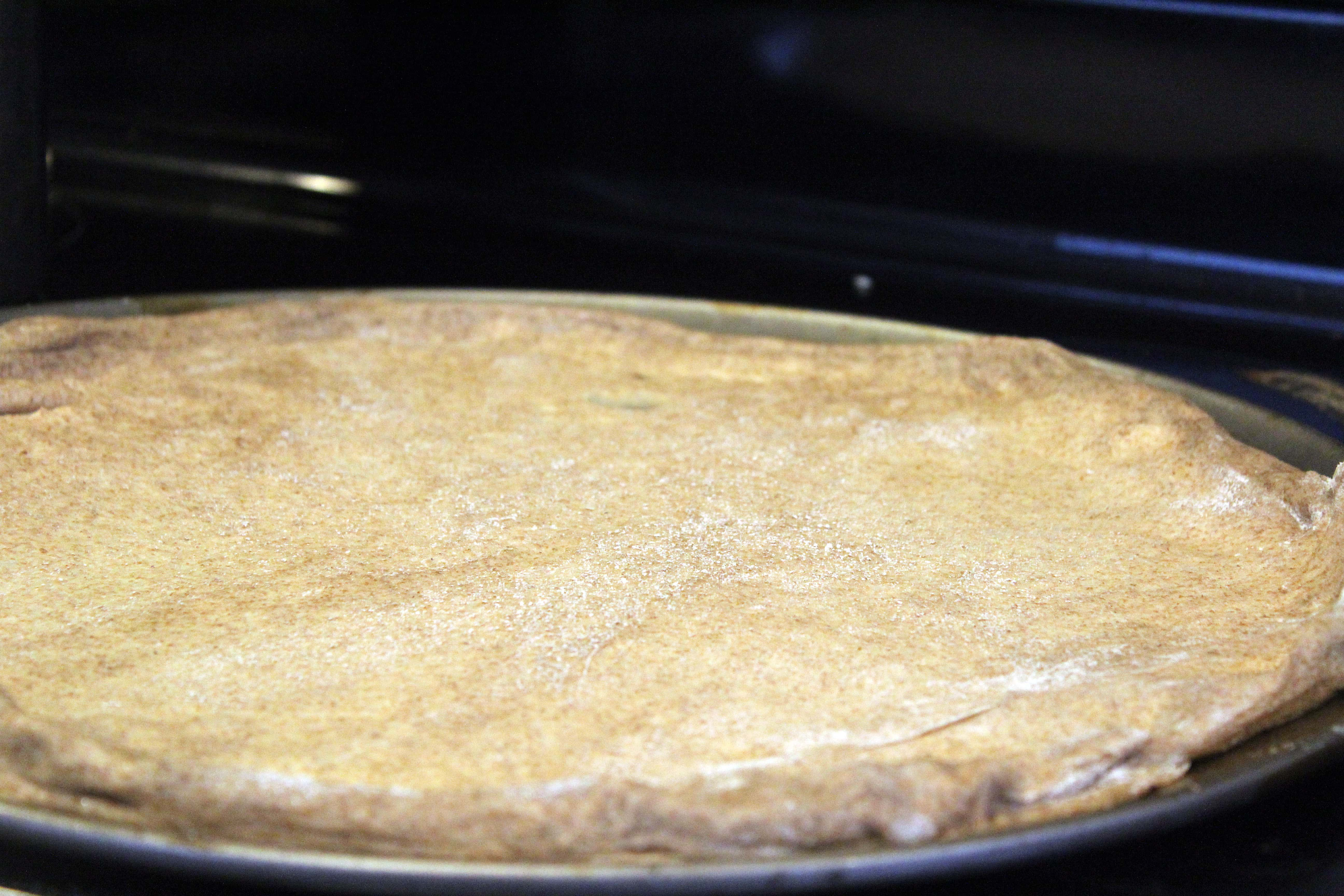 Spread crust until stretched completely