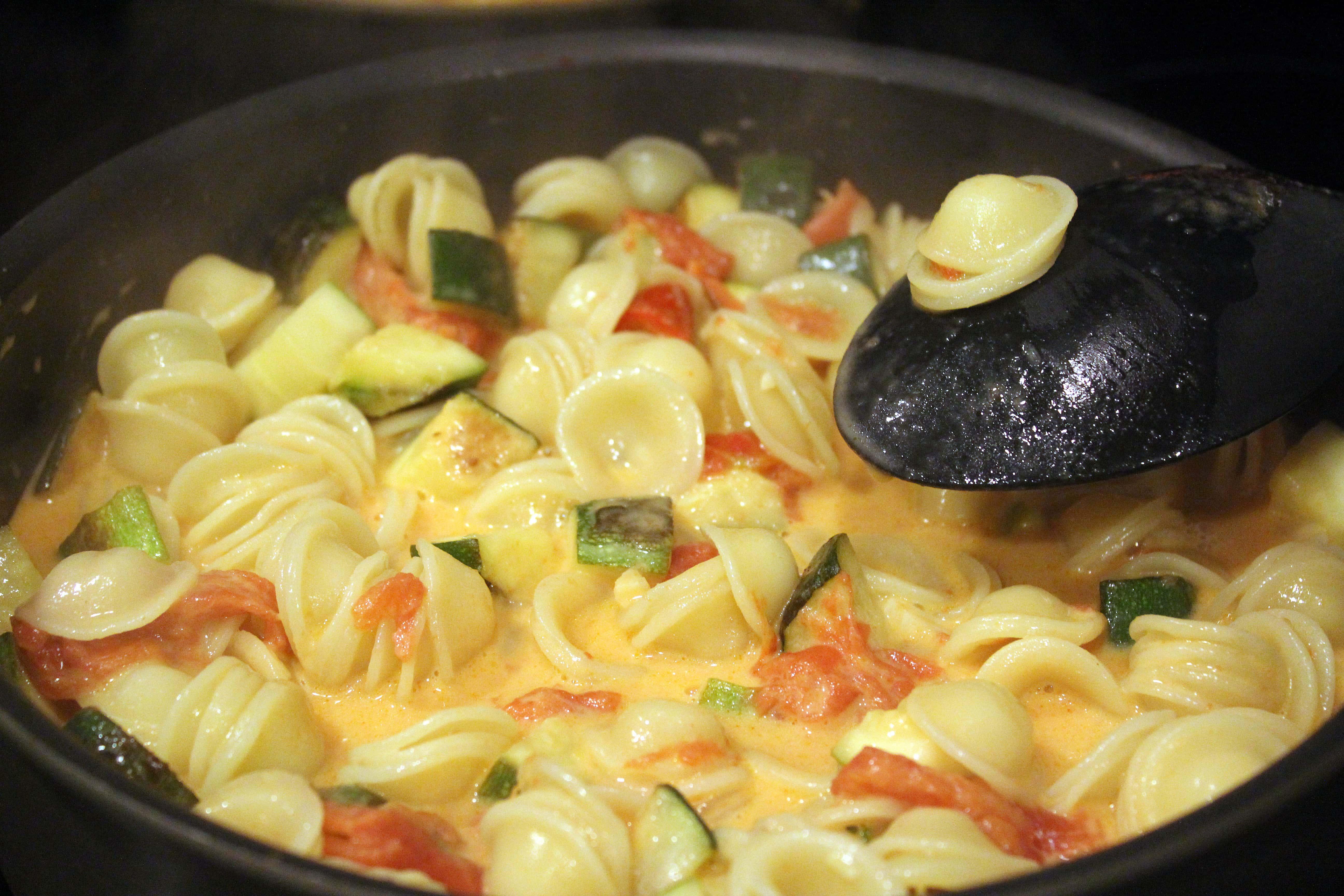 Stir pasta into sauce to coat