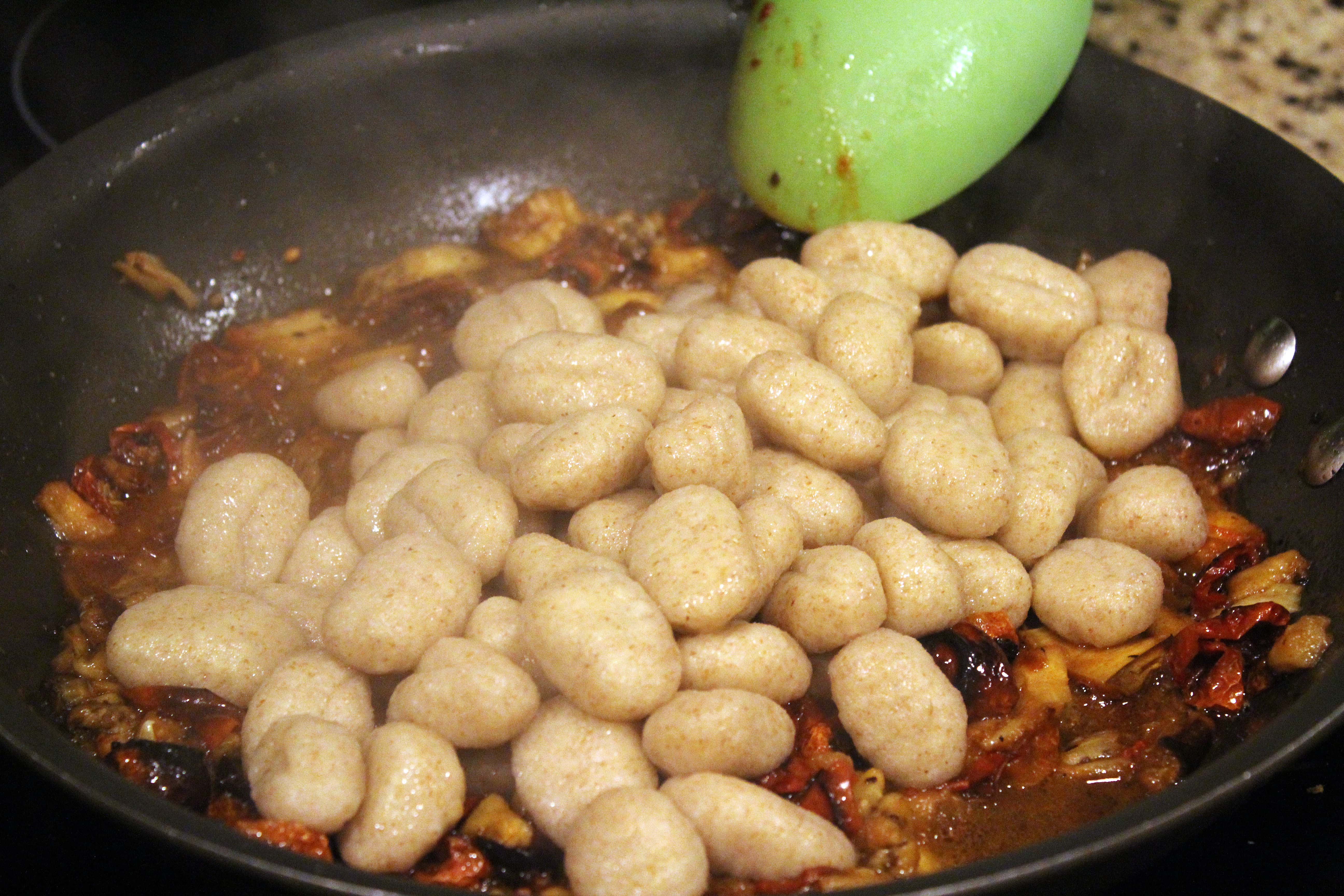 Add cooked gnocchi to sauce