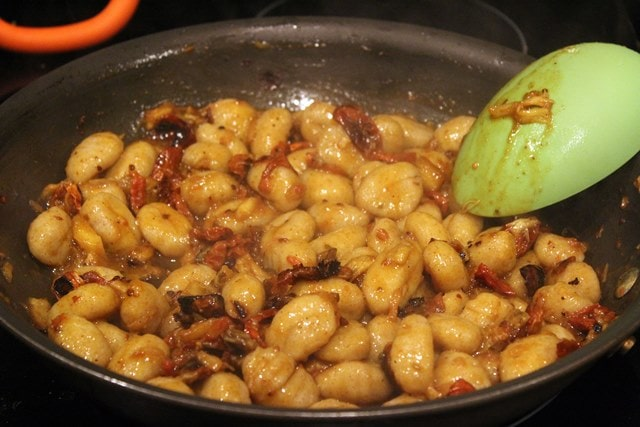 Toss gnocchi with sauce to coat