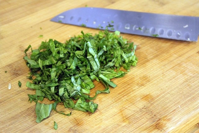 Chop or tear basil