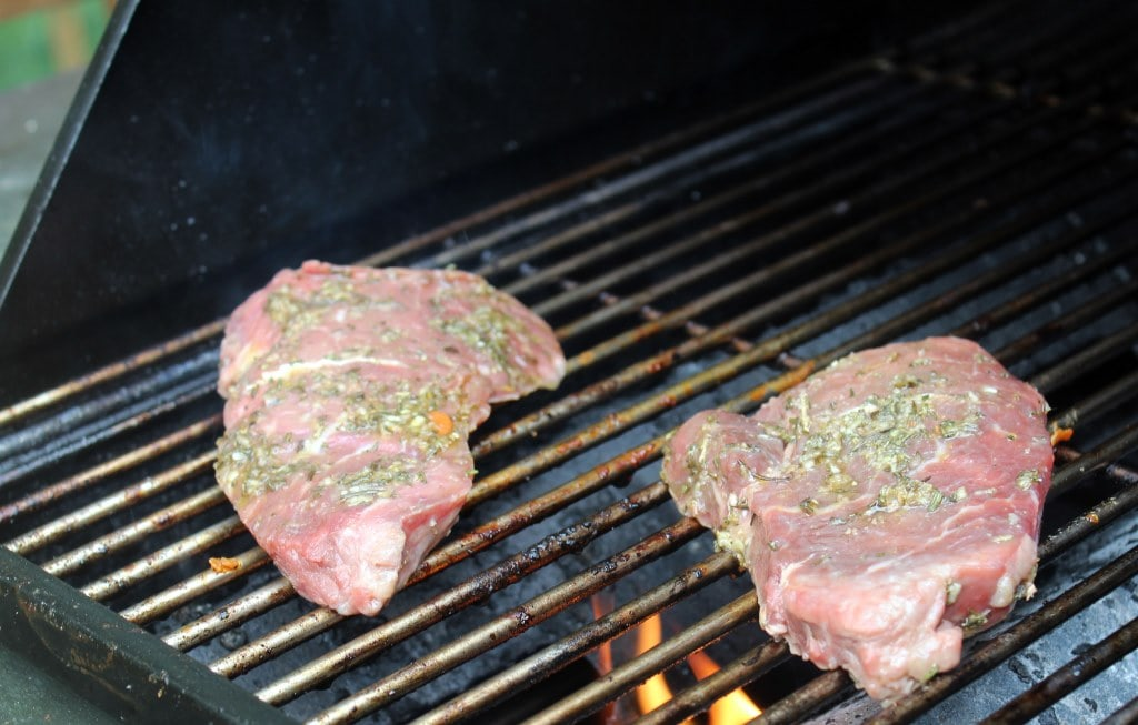 Grill steaks on first side