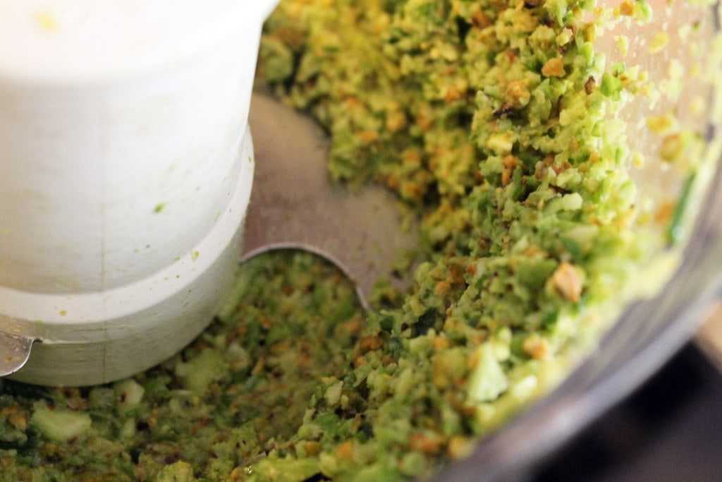 Pulse the pesto until crushed