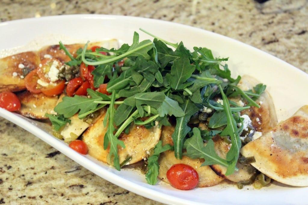 Serve topped with arugula on a platter