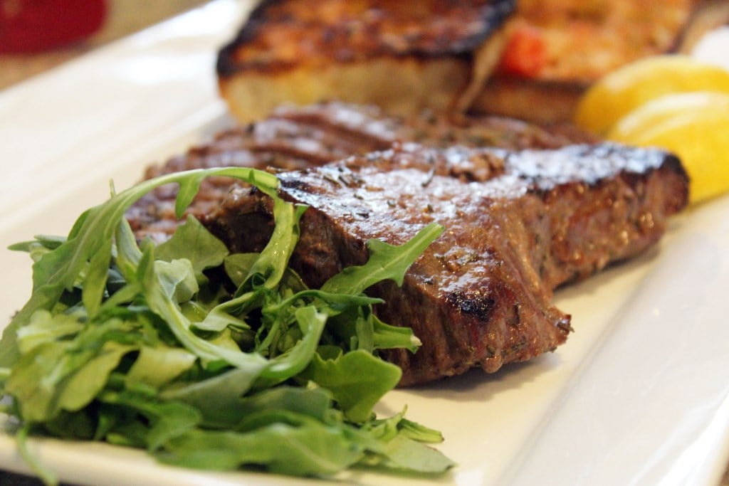 Steak plated with arugula