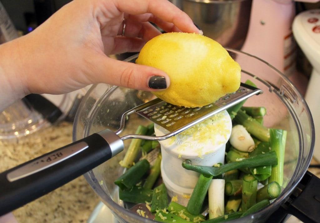 Zest lemon into pesto