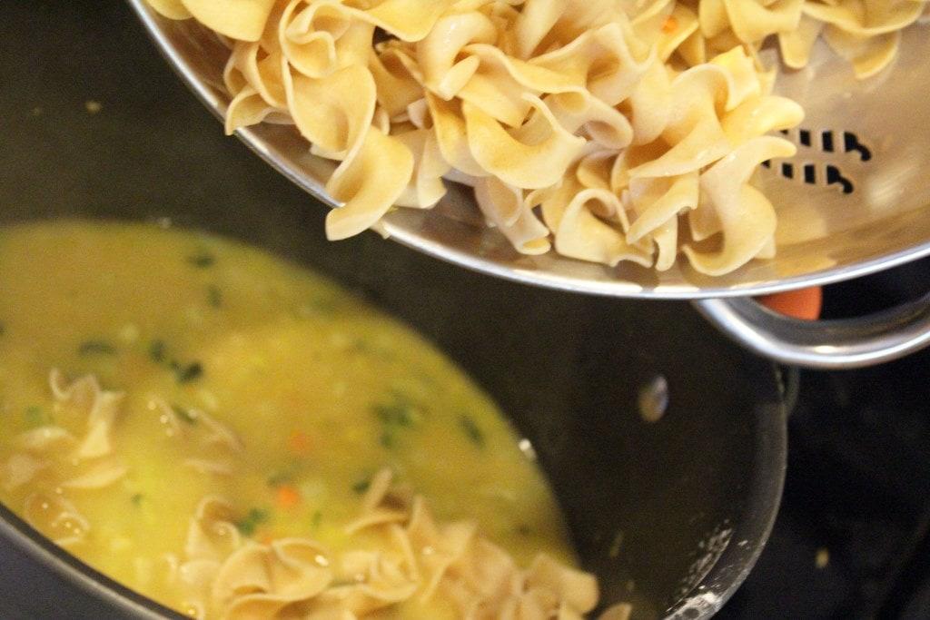 Add noodles back to pot