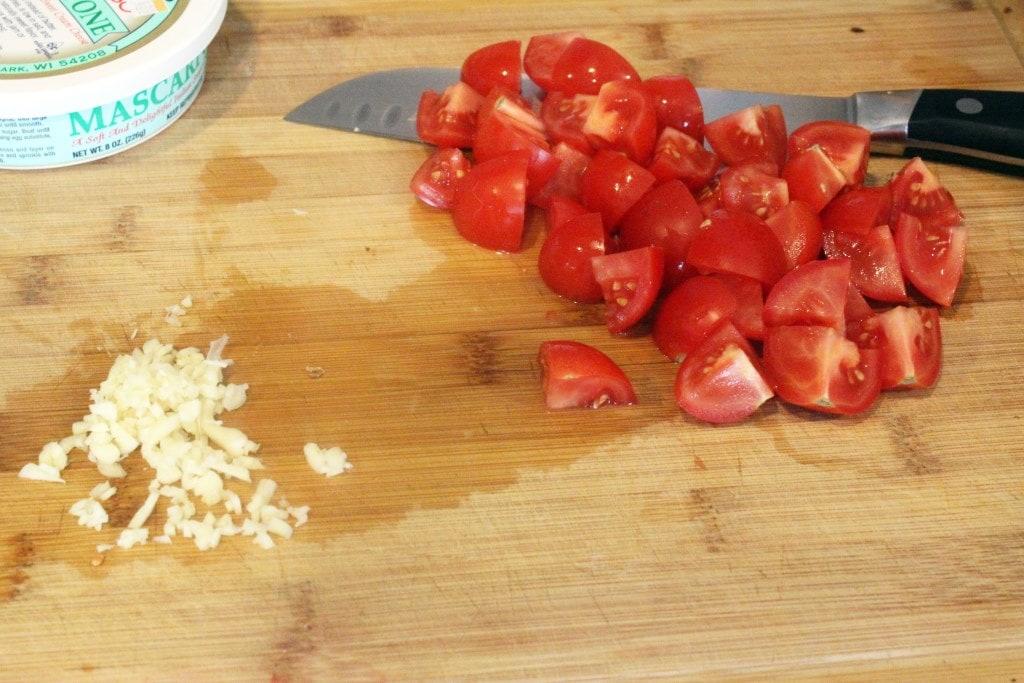 Chop tomatoes and garlic