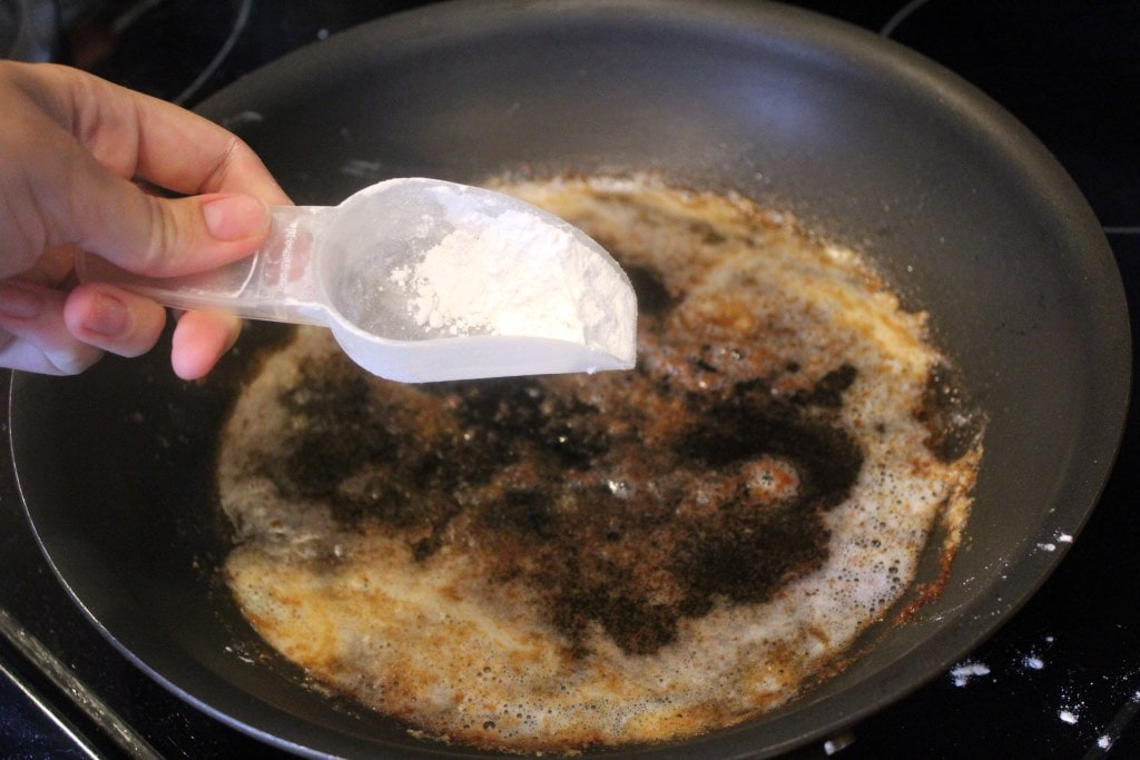 Sprinkle flour into drippings
