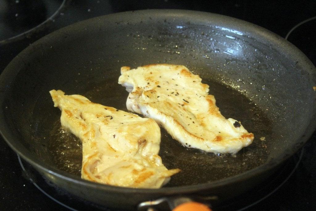 Turn chicken in fat