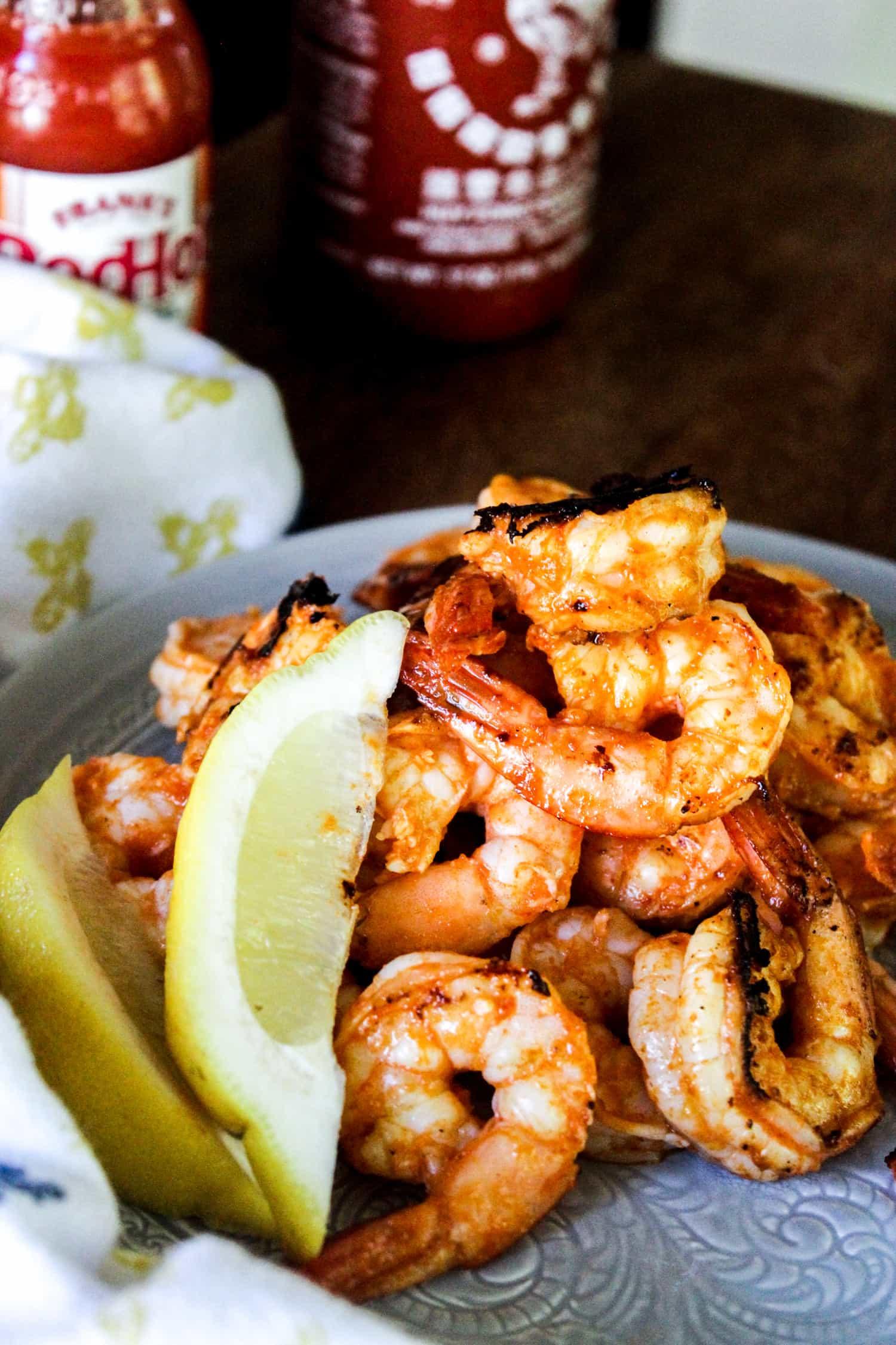 pile of firecracker shrimp with lemon