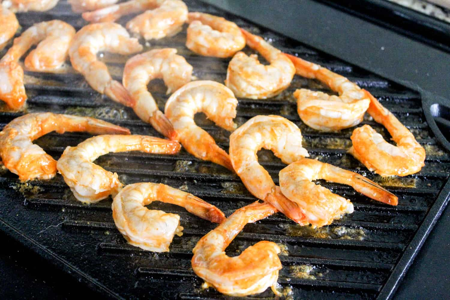 shrimp on grill pan with hot sauce