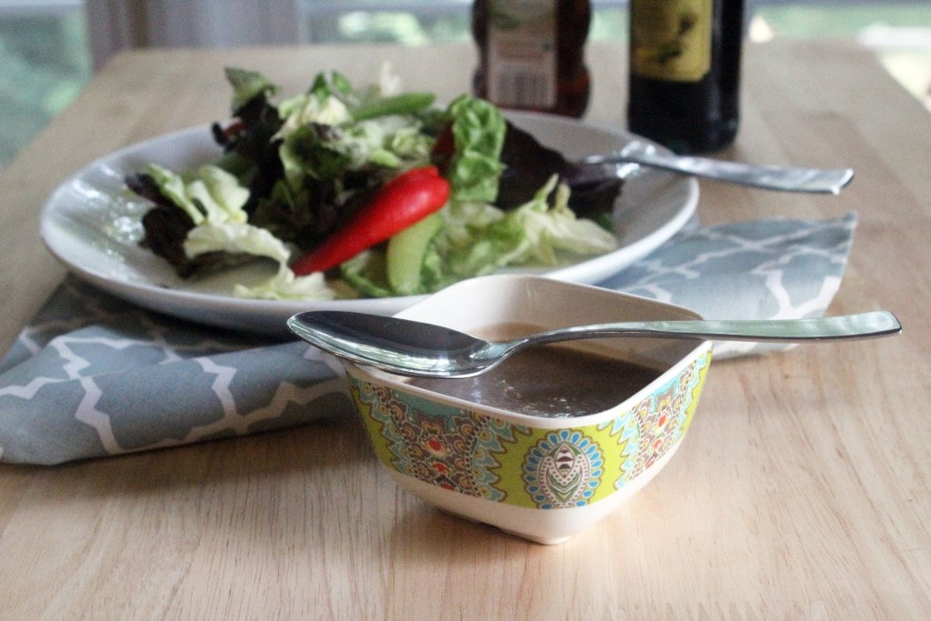Salad with small dressing bowl