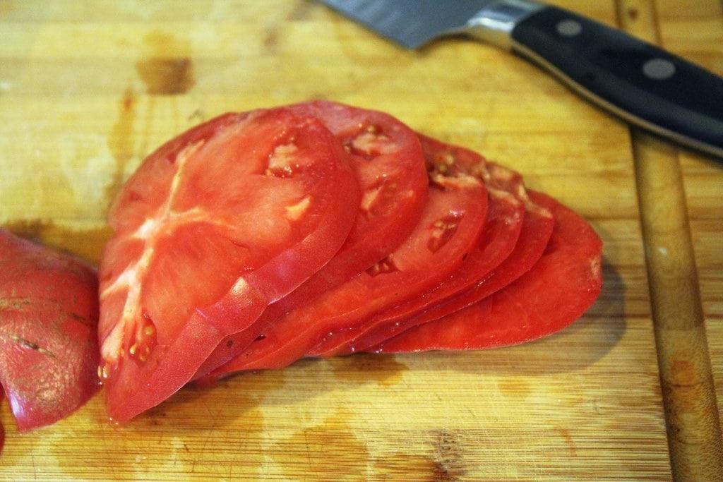 Thinly slice tomato