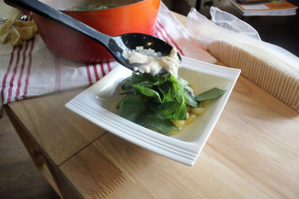 Top spinach with soup