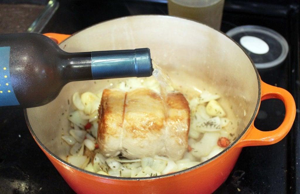 Add wine to pork and veggies