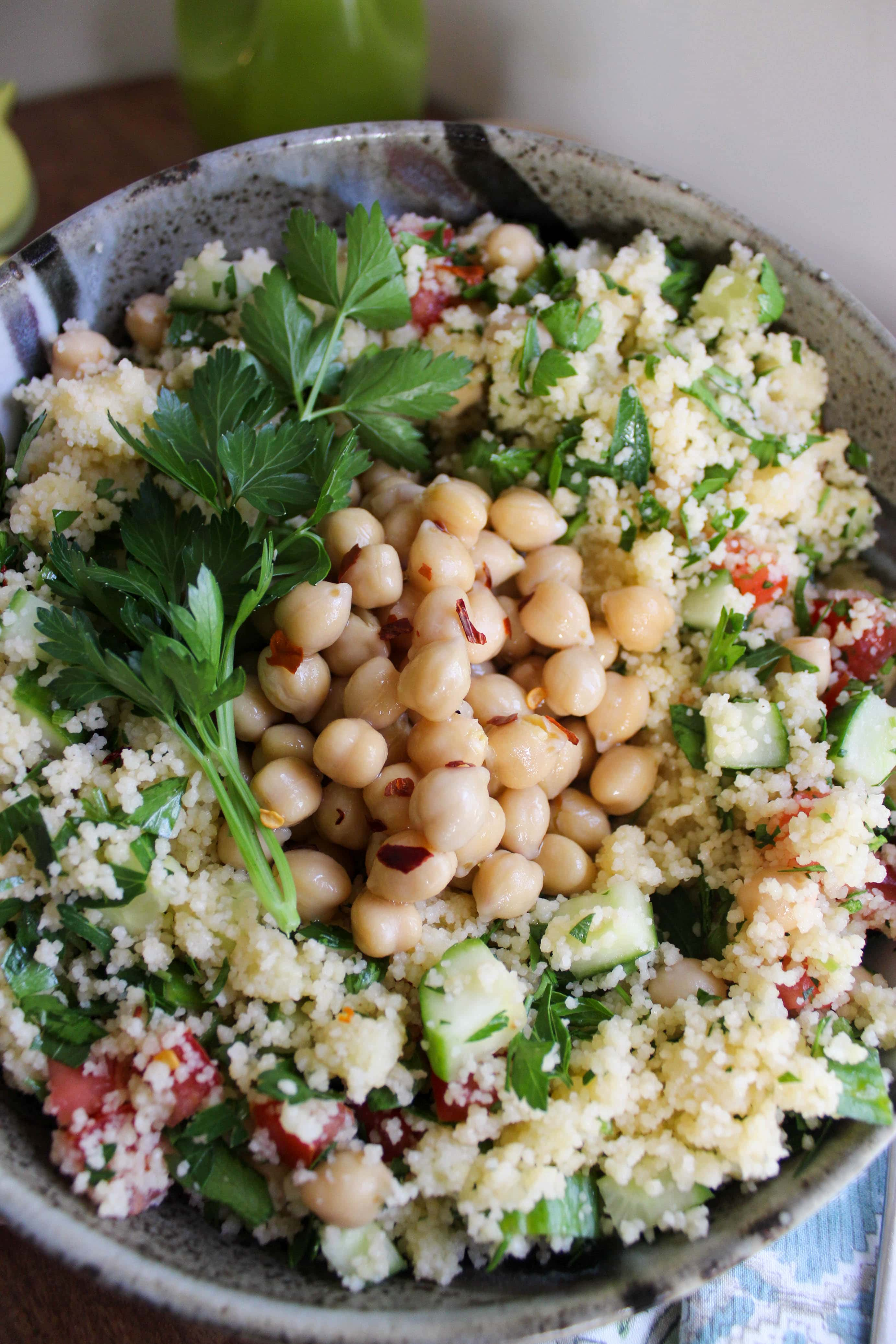 top view of couscous salad topped with parsley and marinated garbanzo beans