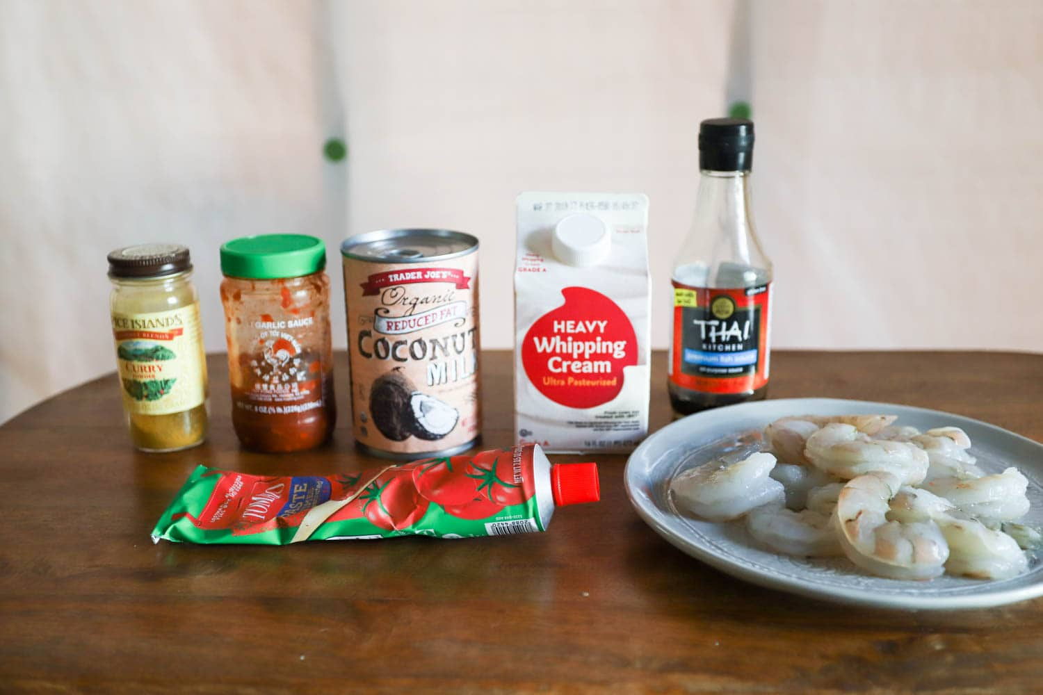 ingredient bottles and raw shrimp for coconut curry