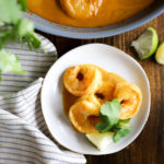 small plate of 3 shrimp with curry cream sauce