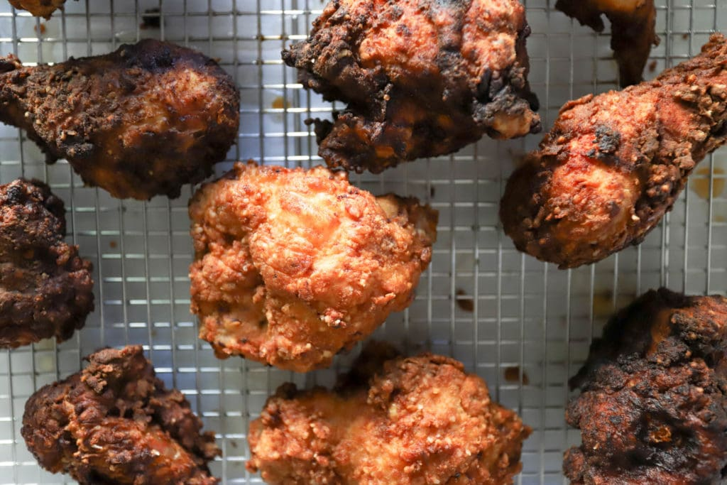 fried bone in chicken pieces top view on rack