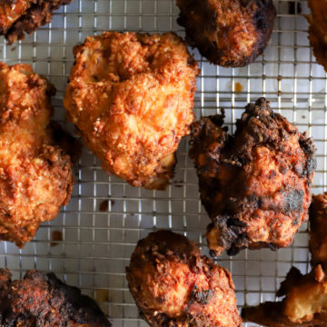 buttermilk fried chicken on wire cooling rack