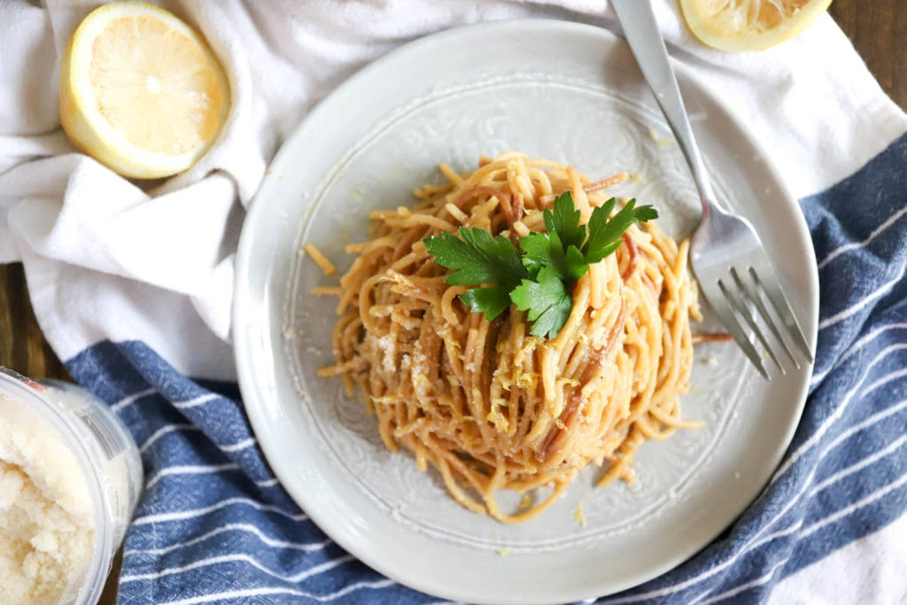 plate of whole wheat spaghetti with parsley