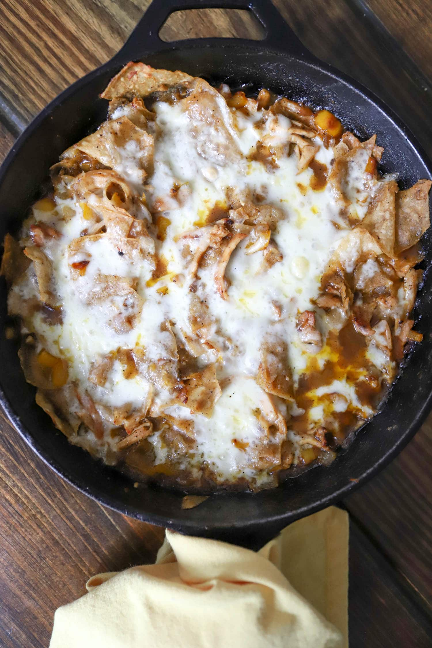 How to make chilaquiles verdes with chips, chicken, and green enchilada sauce. Funnyloveblog.com