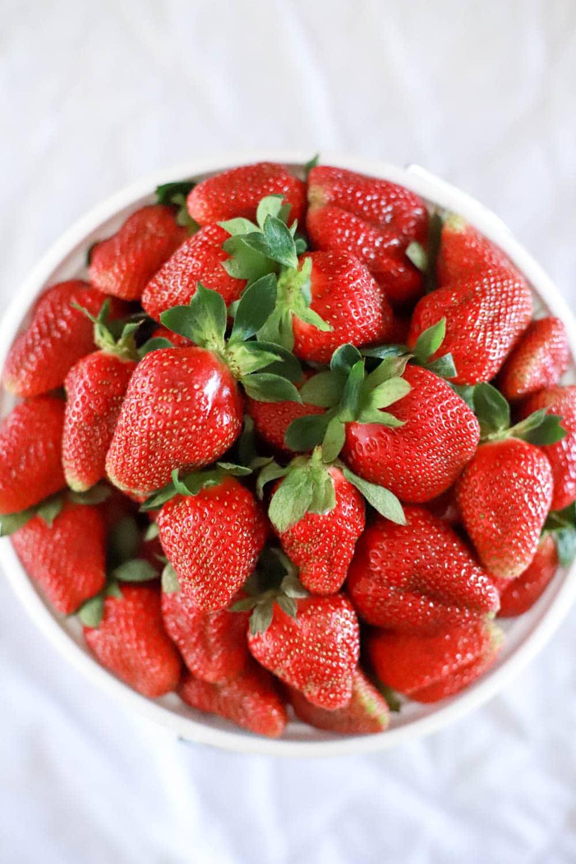 gallon of fresh summer strawberries