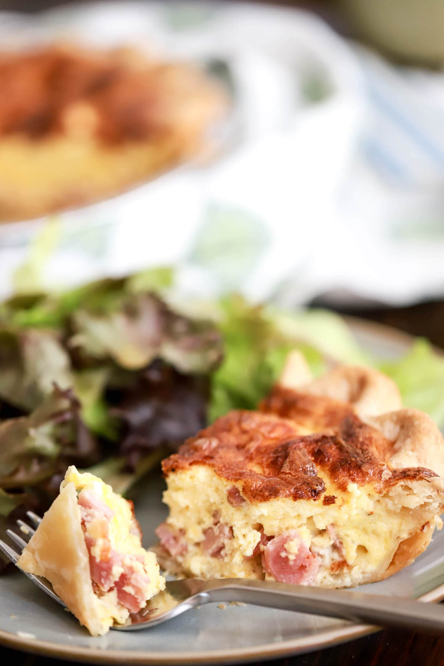 bite of ham and cheese quiche