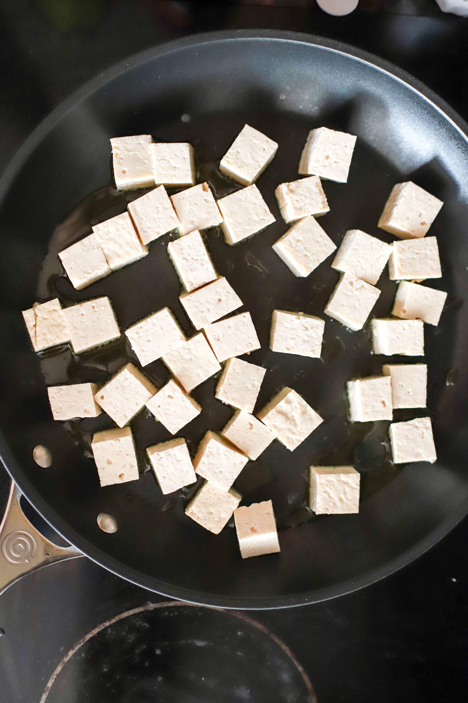 tofu frying in pan 1