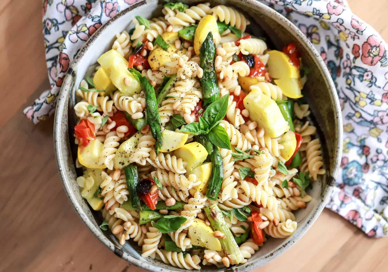 round bowl full of pasta salad with veggies