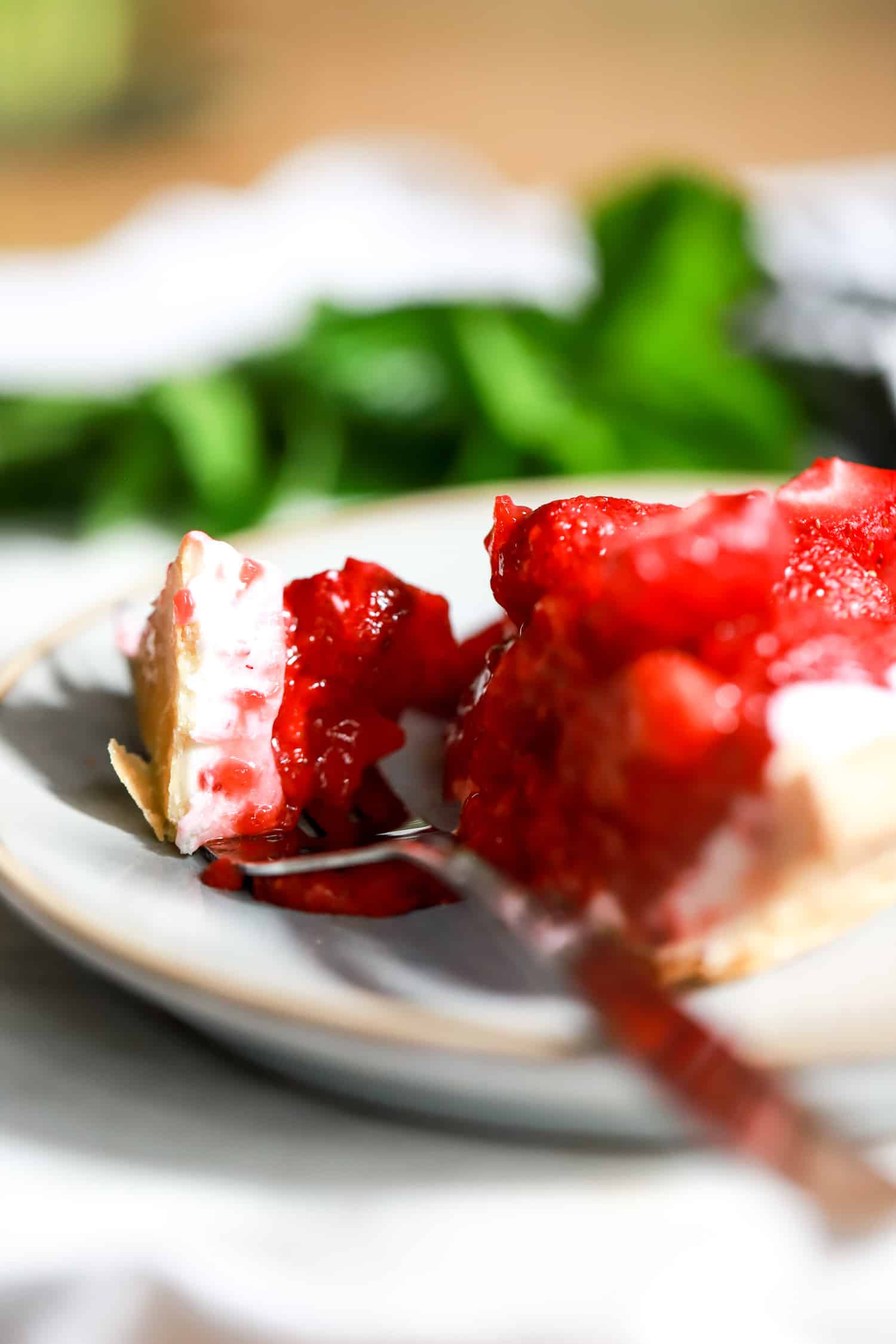 single bite of cream cheese strawberry pie on a fork