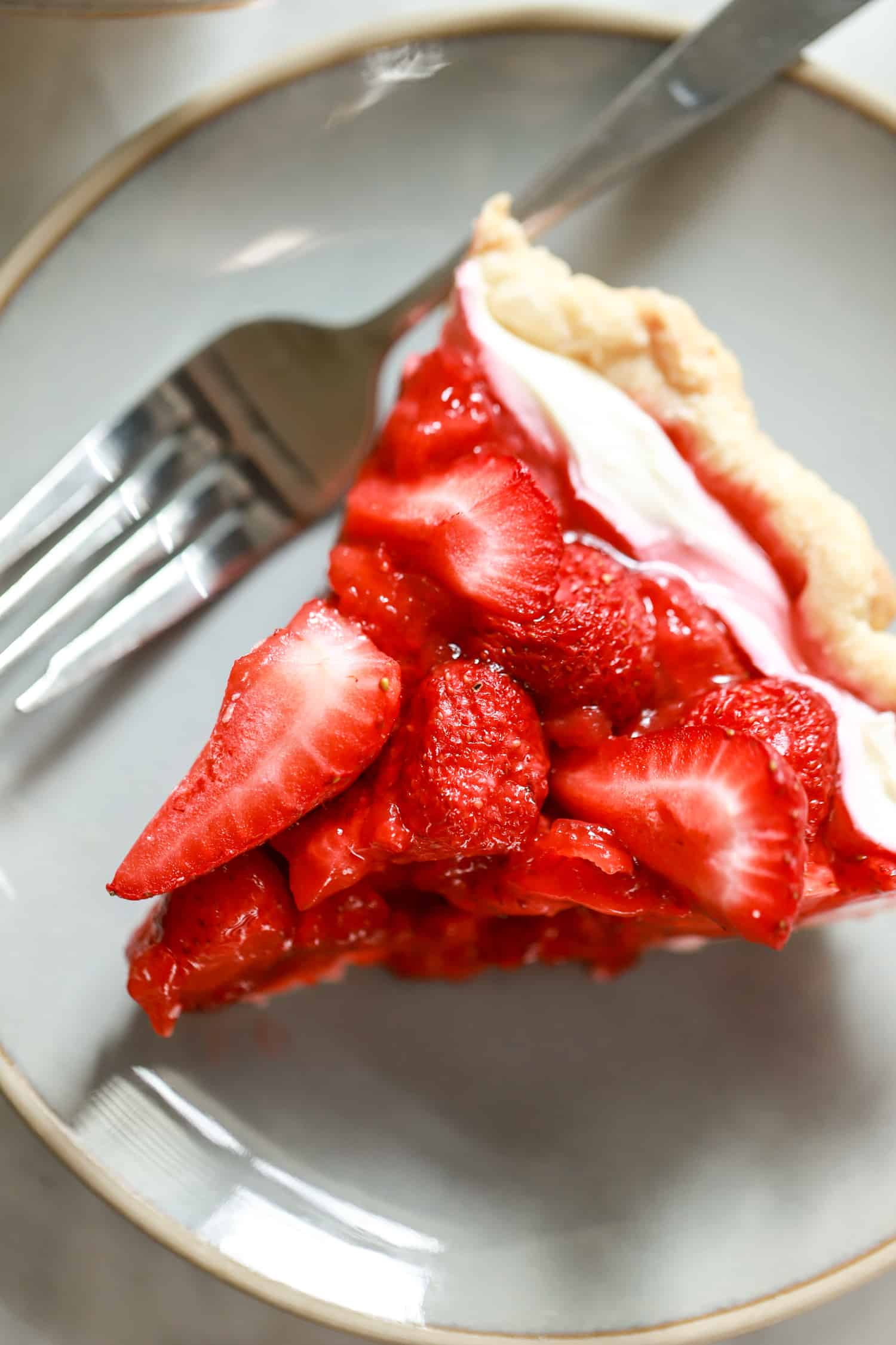 slice of cream cheese strawberry pie with plate and fork