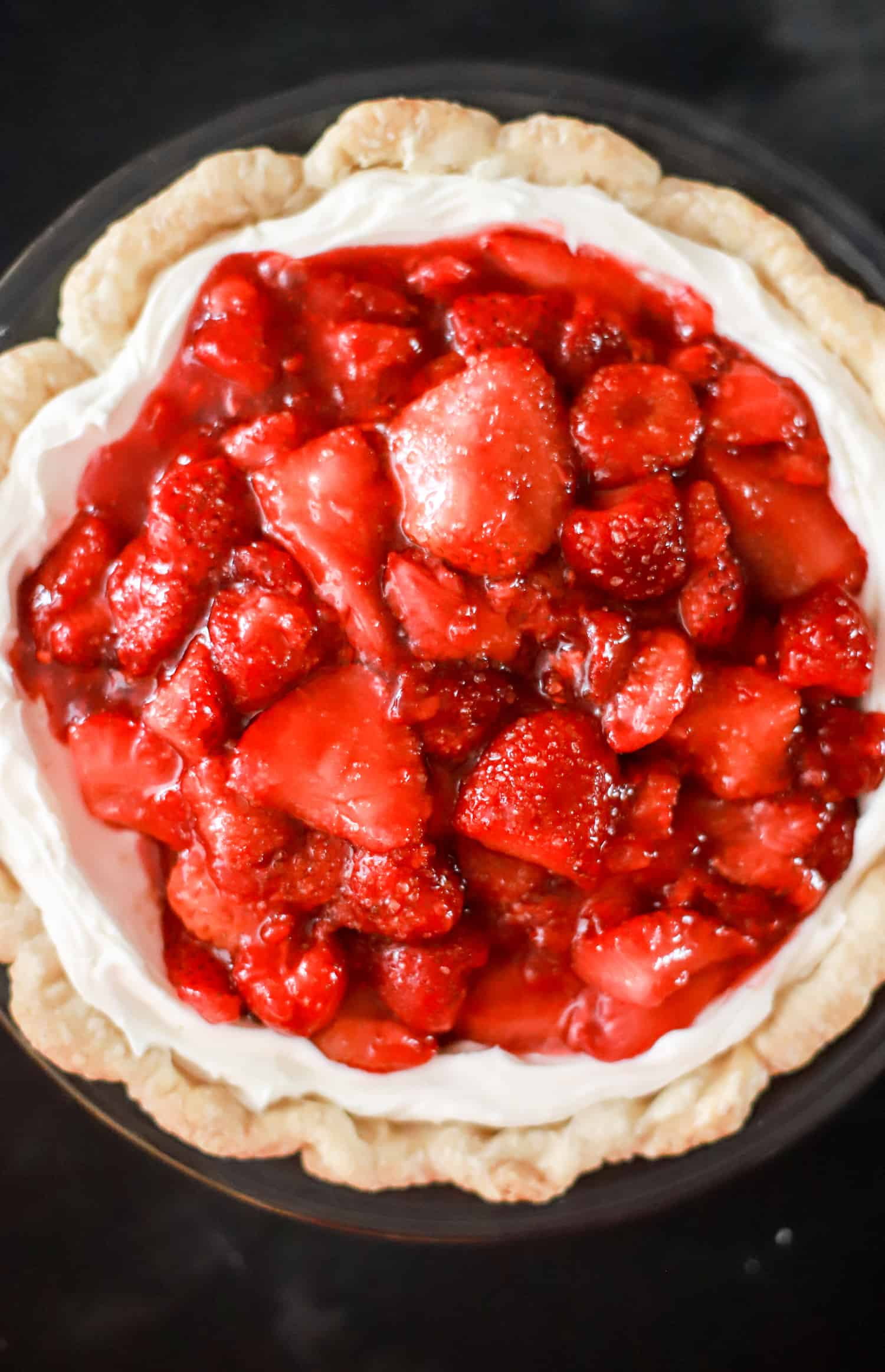 strawberries in pie crust before chilling
