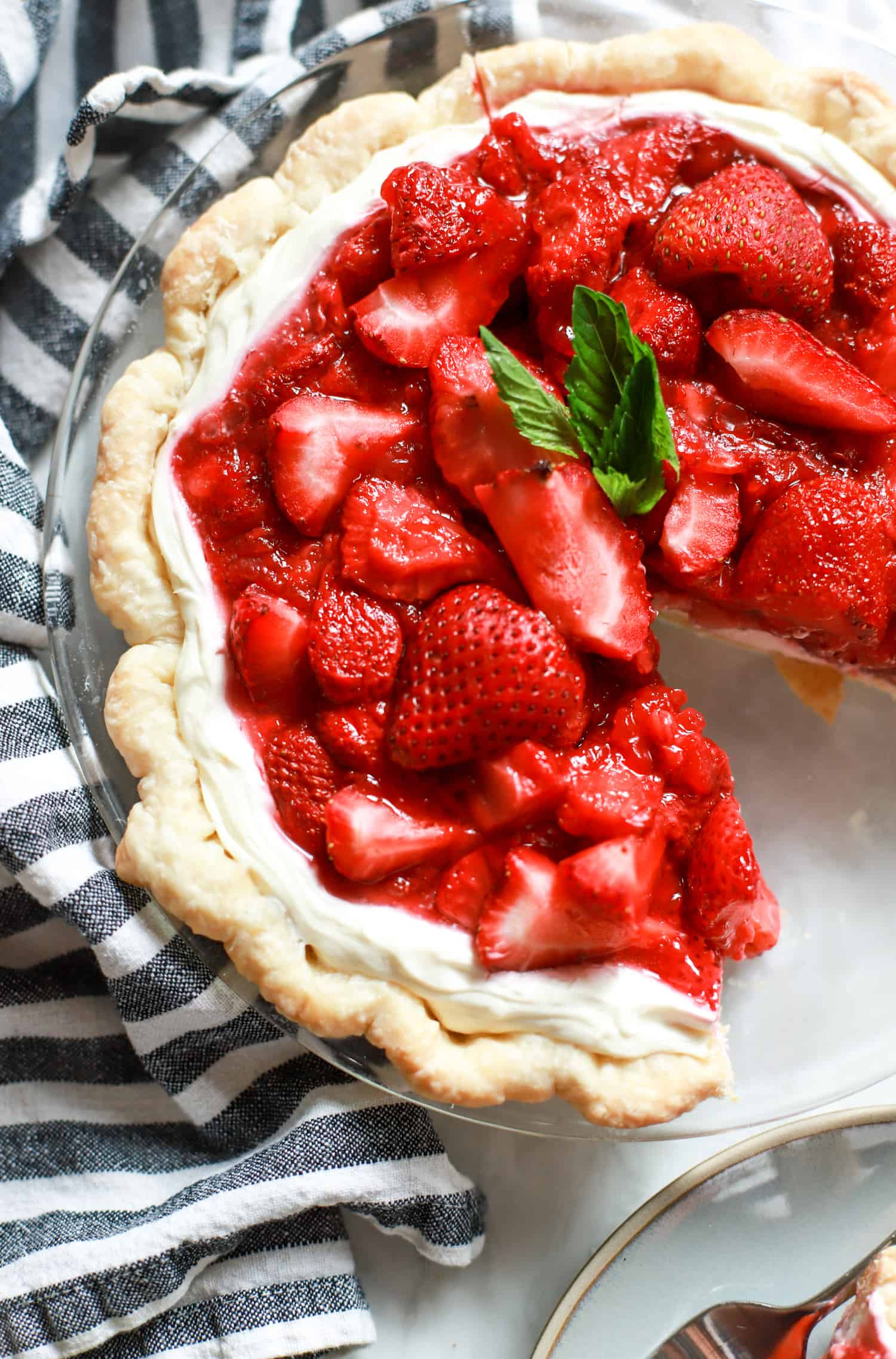 strawberry cream cheese pie with one slice missing