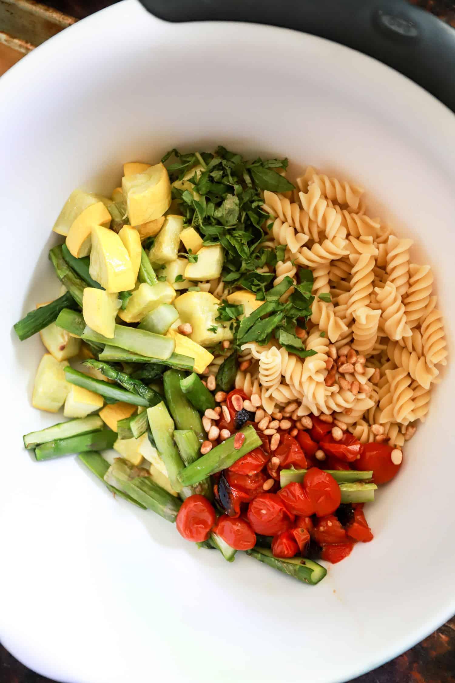 unmixed vegan pasta salad in white bowl