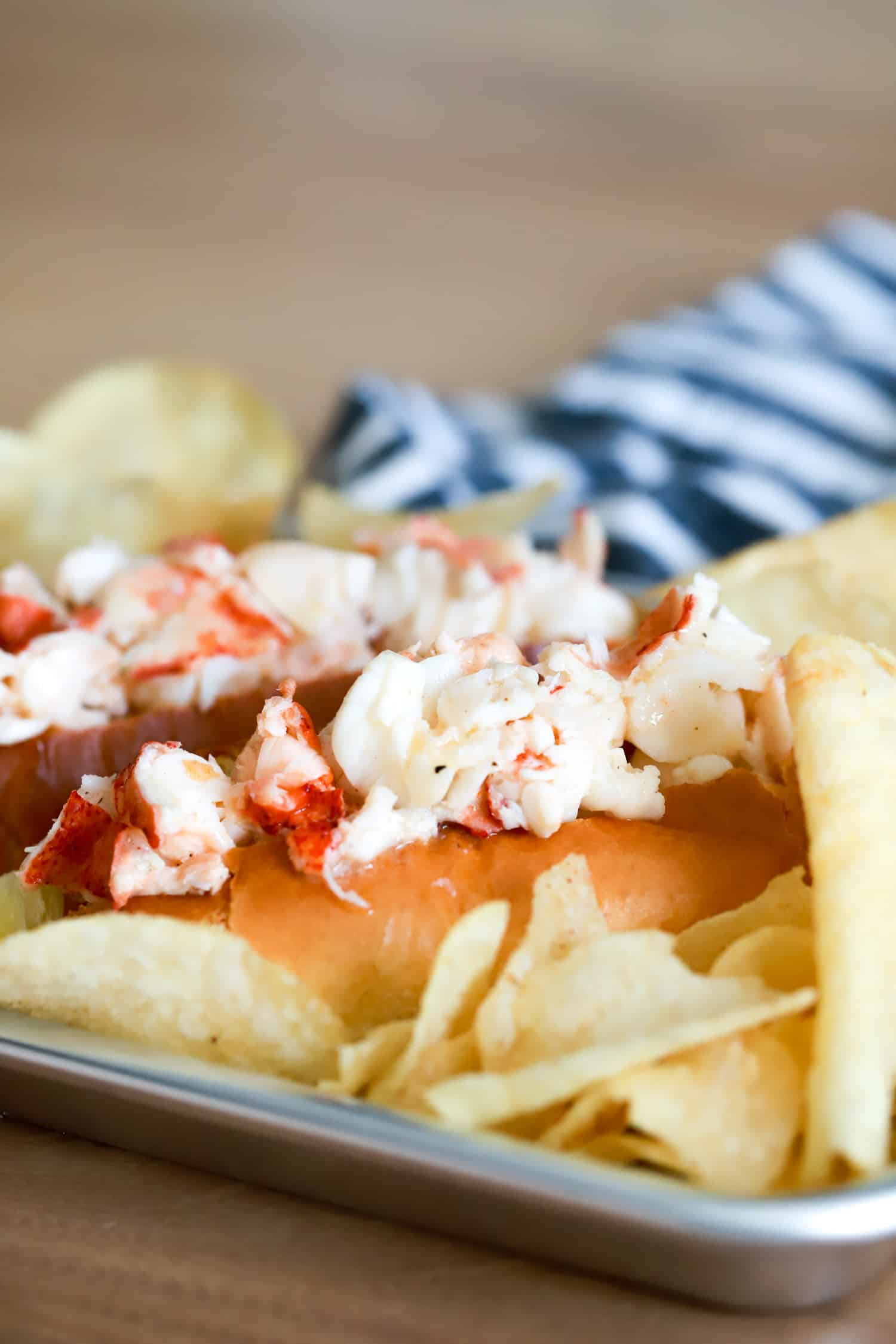 warm lobster rolls with potato chips